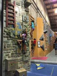Grace climbing.
