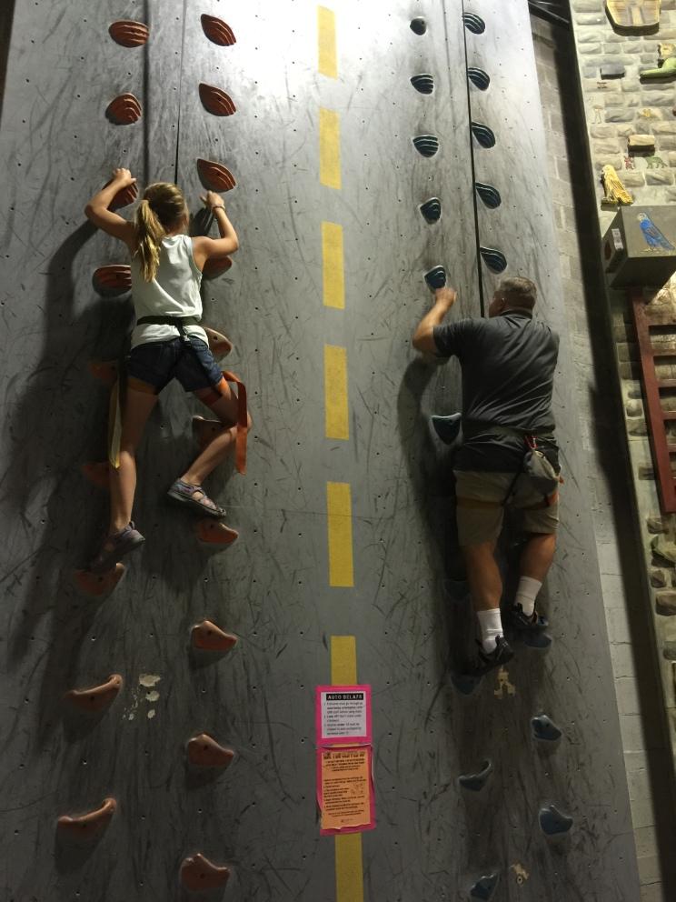 Hailie and Randy climbing.