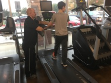 Working on walking on the treadmill with his trainer, Lee.